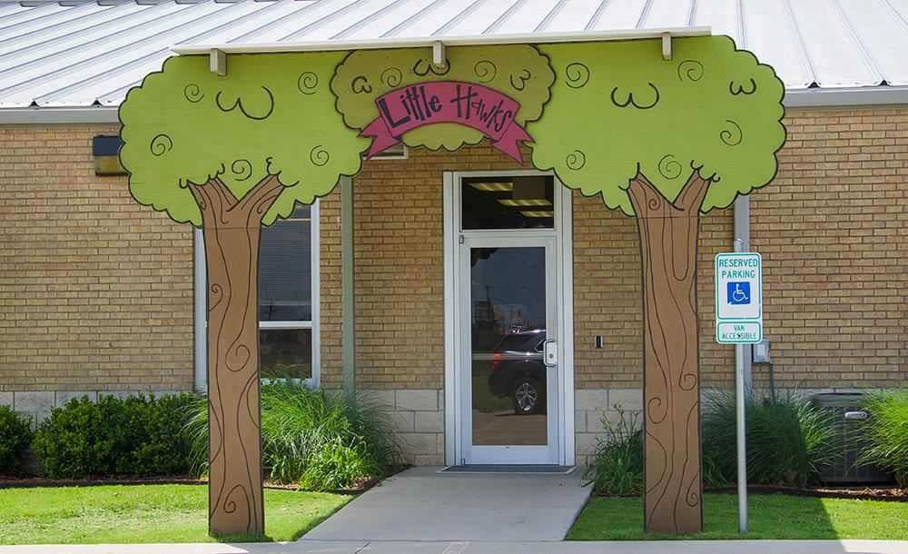 entrance to Little Hawks with graphical tree arch