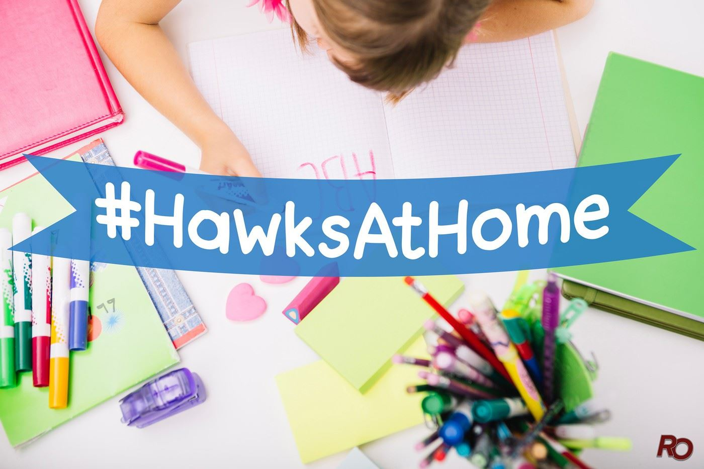 Child coloring with #HawksAtHome