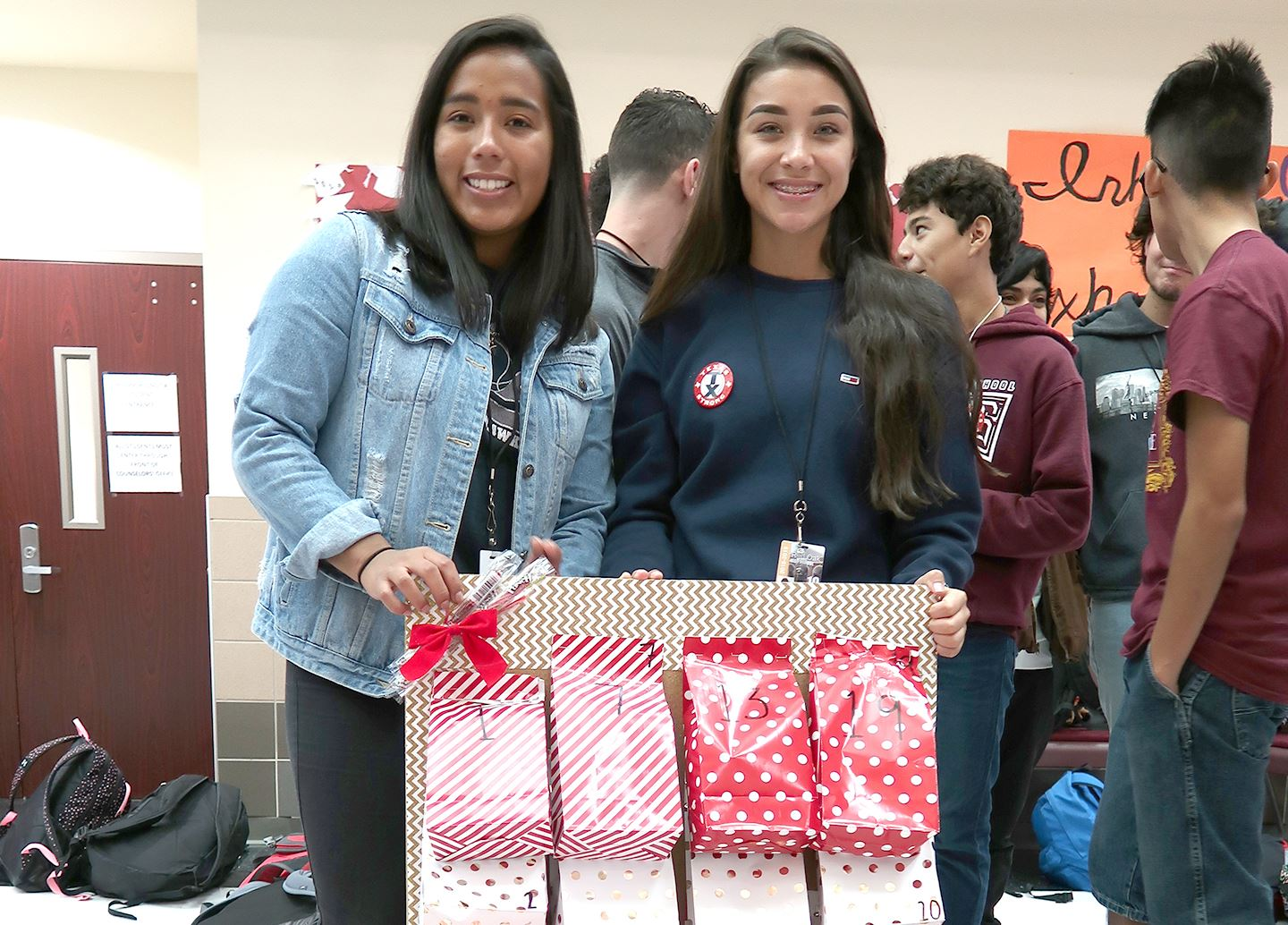 two female students showing off their service project for needy families