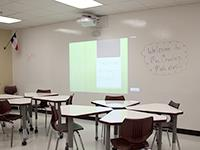 classroom with interactive projector and white board wall
